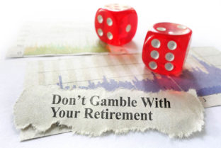 Dont Gamble With Your Retirement Newspaper Headline With Dice And Stock Market Graphs